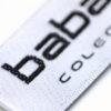 Etiqueta tejida en satén orillos tejidos