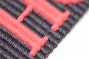 Detalle del relieve en cinta textil